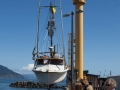 Fishing boat being hoisted onto dry dock at Port Orford