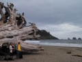 Mom & Kim at giant driftwood log on First Beach