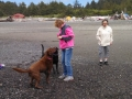Mom & Kim playing with the pups on First Beach