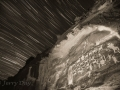 Star trails over the Great Hunt rock art panel - Nine Mile Canyon - black and white