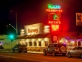 Street scene with Margie's Merry-Go Round Restaurant Neon
